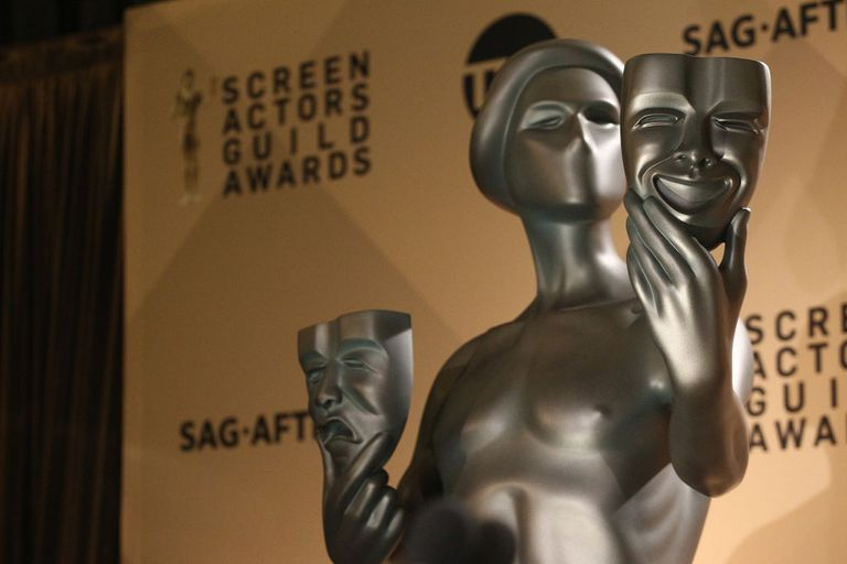 Screen actor's guild statue in front of screen