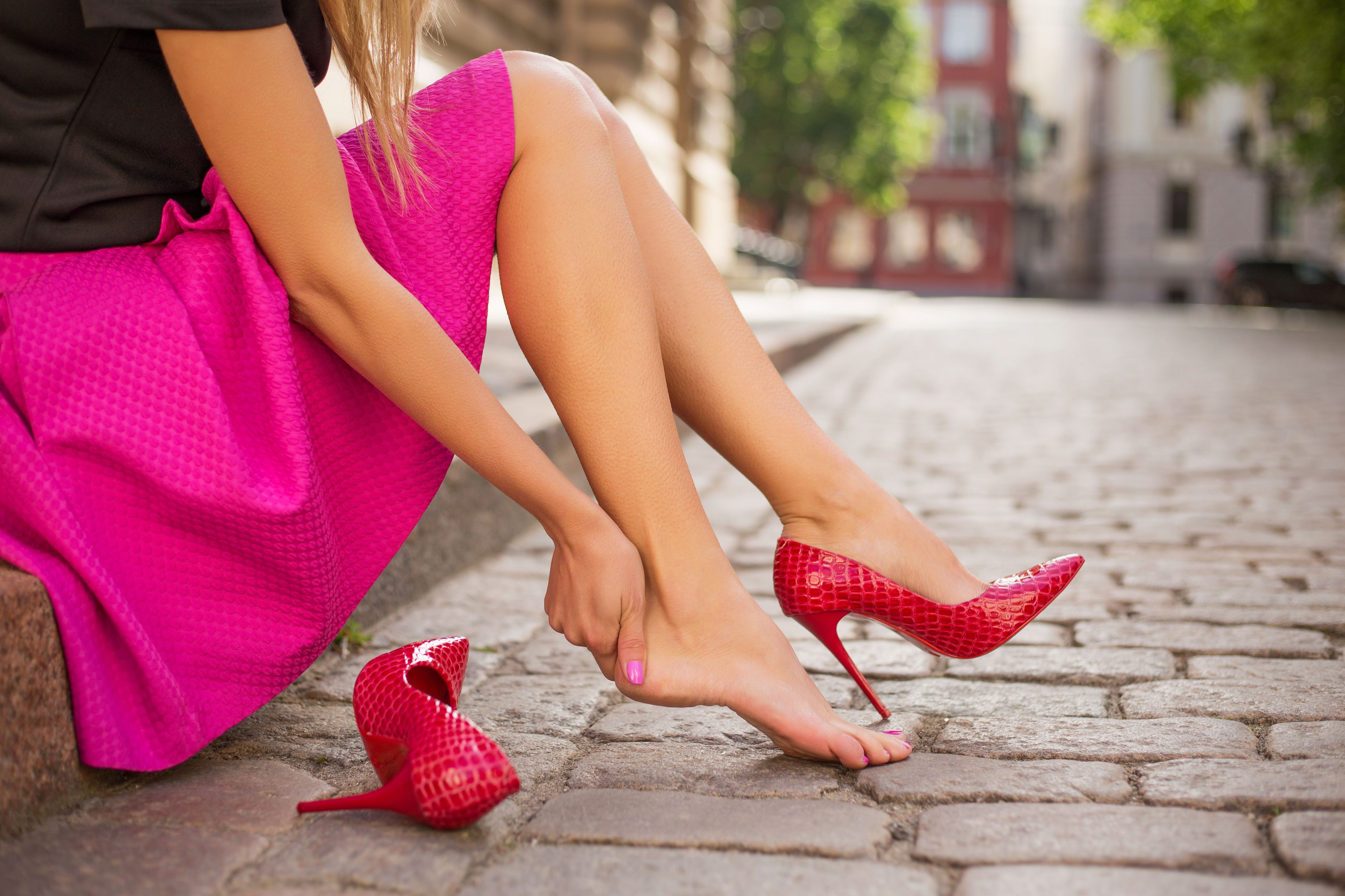 A woman changing her shoes