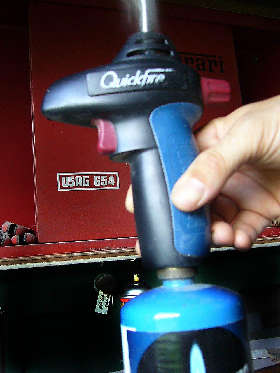 Screw nozzle onto tank.