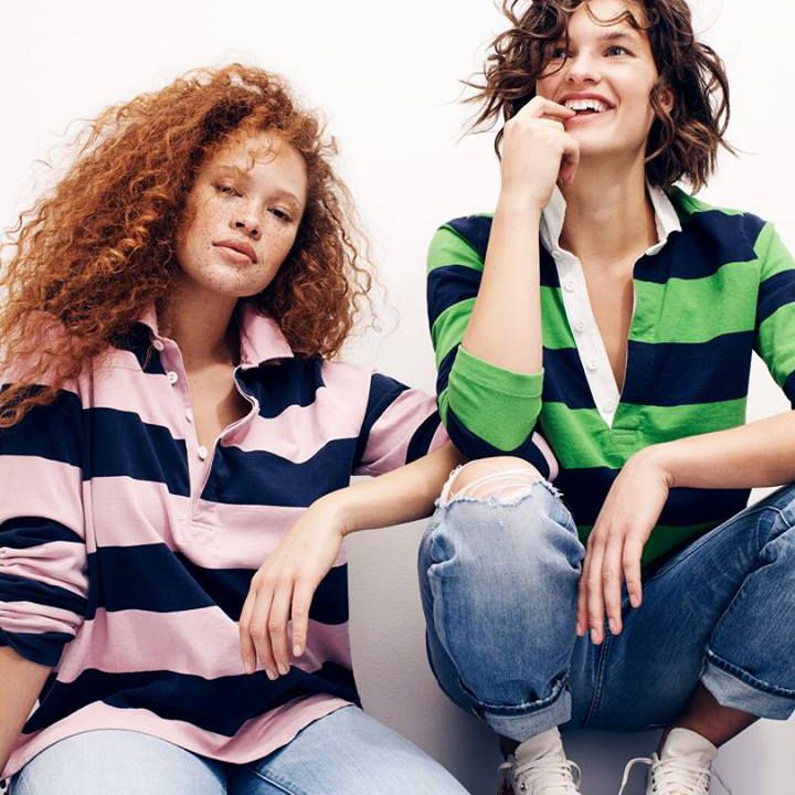 Two women wearing striped polos from J. Crew
