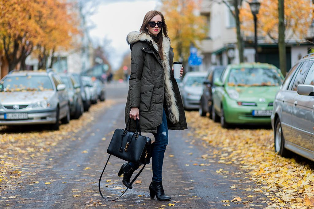 Street style in a trendy puffer jacket and jeans