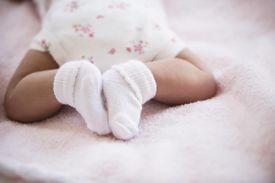 Close up of mixed race newborn baby's feet