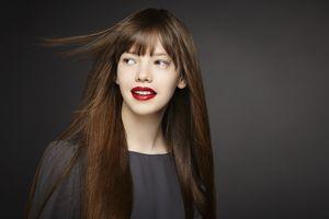 studioportrait of girl with windblown hair