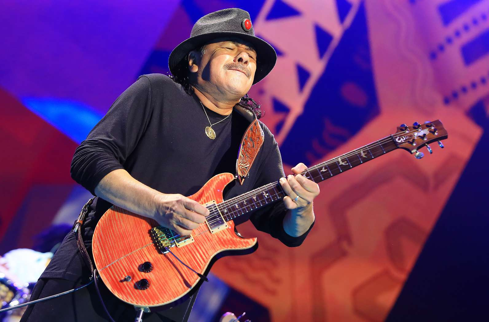 Carlos Santana performing on on August 14, 2014 at the Sprint Center in Kansas City, Missouri