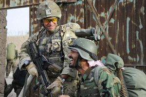 A British soldier shares a joke with an Afghan National Army warrior during Operation OMID HAFT Photo By: Sergeant Alison Baskerville RLC