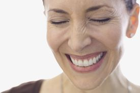 Close-up portrait of smiling woman with eyes closed