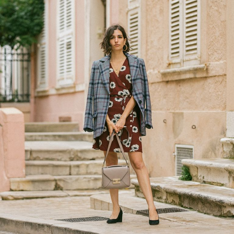 Woman in tweed blazer and floral dress