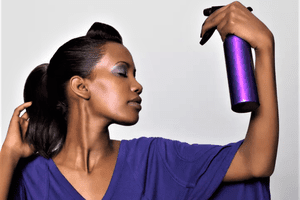 Woman spritzing herself