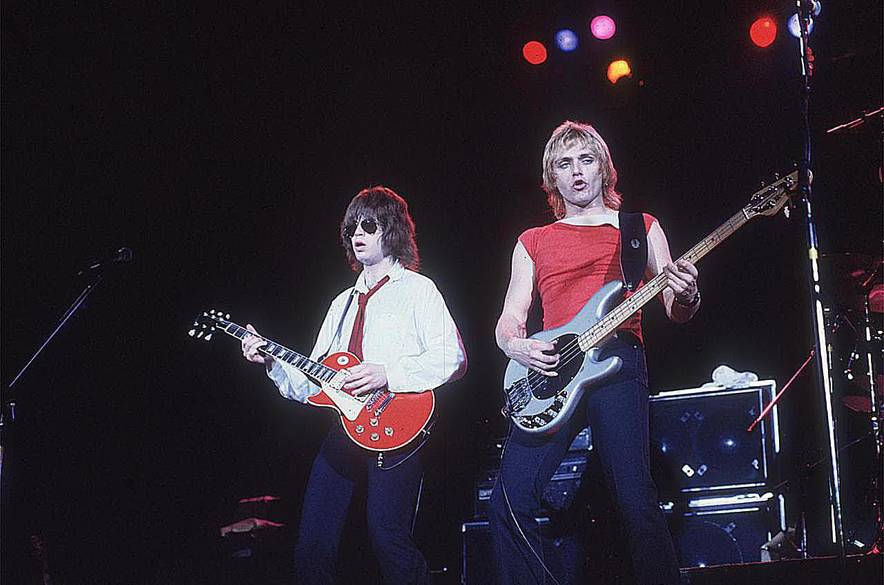 Elliot Easton and Benjamin Orr performing on stage with the group the Cars