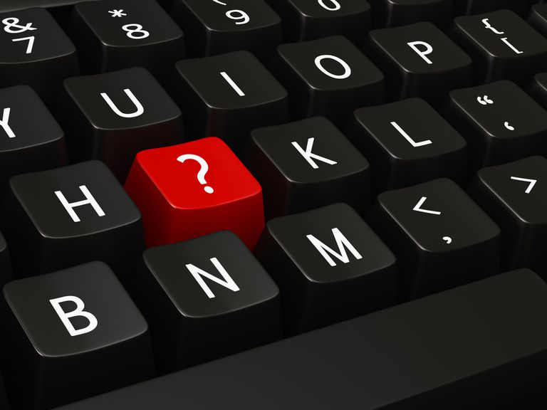 Keyboard with a red question mark key in place of the J key
