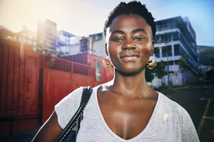 A young lady with facial piercings.