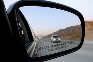 Car in rear view mirror