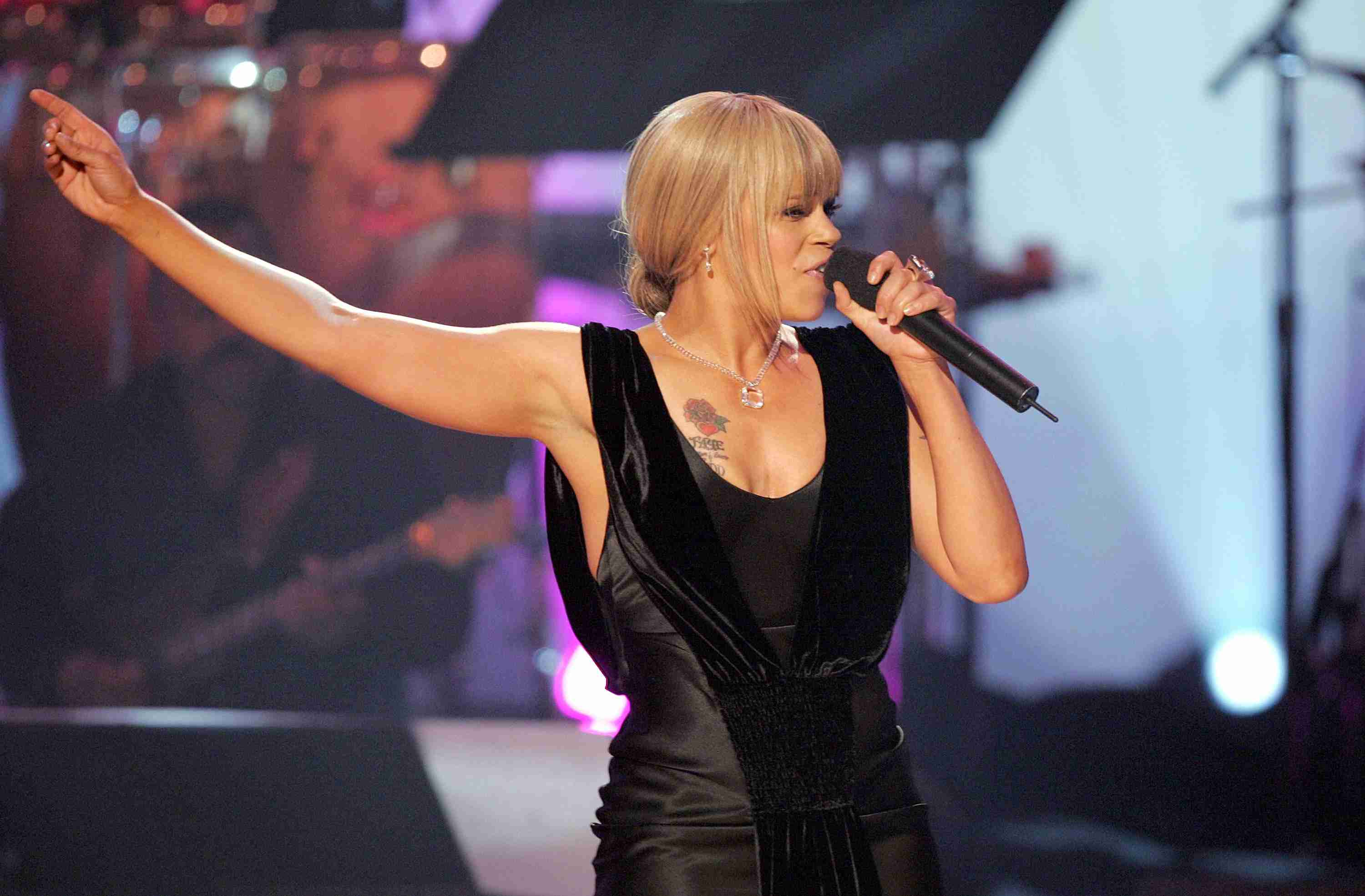 Faith Evans performing onstage