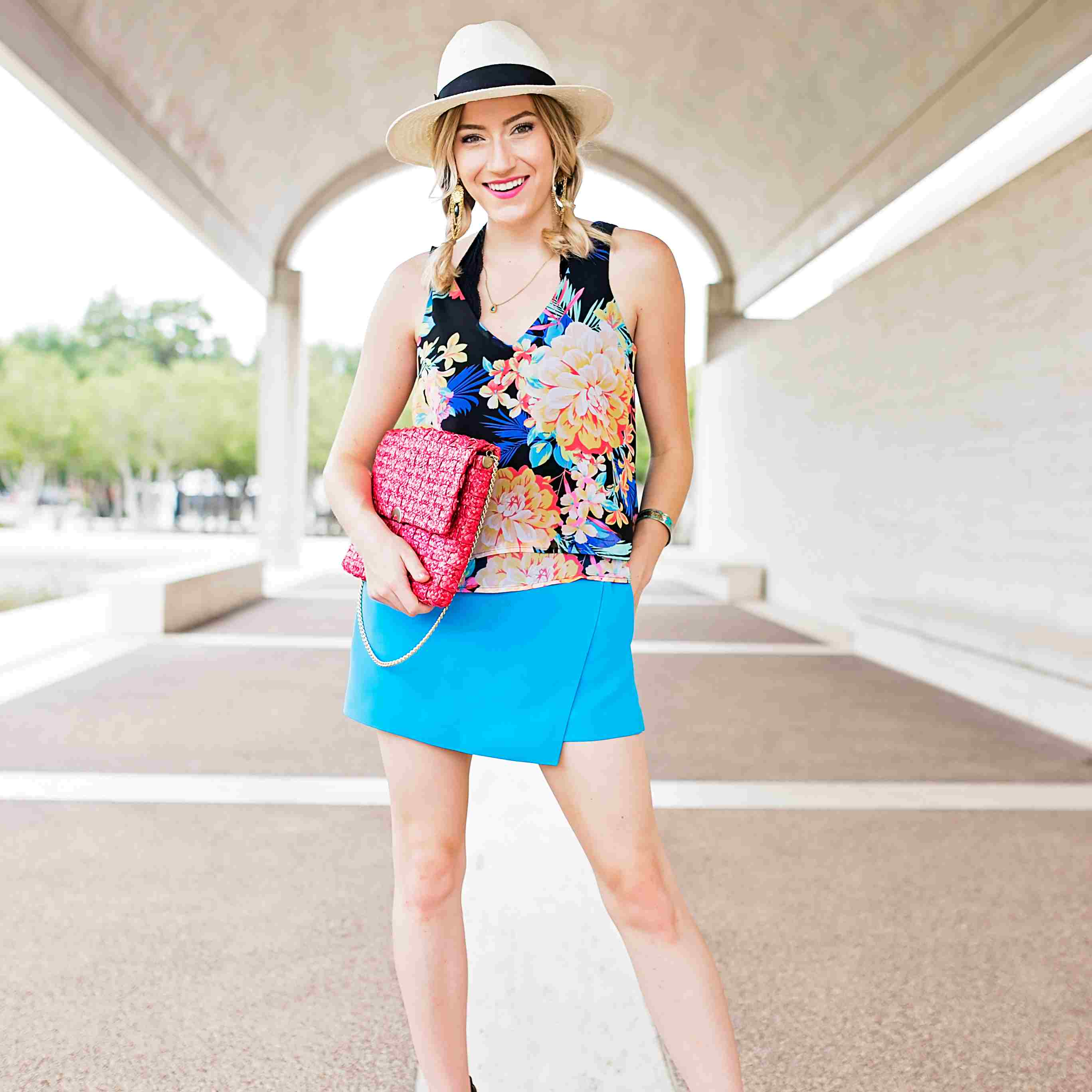 Woman in floral top and blue skirt for summer fashion