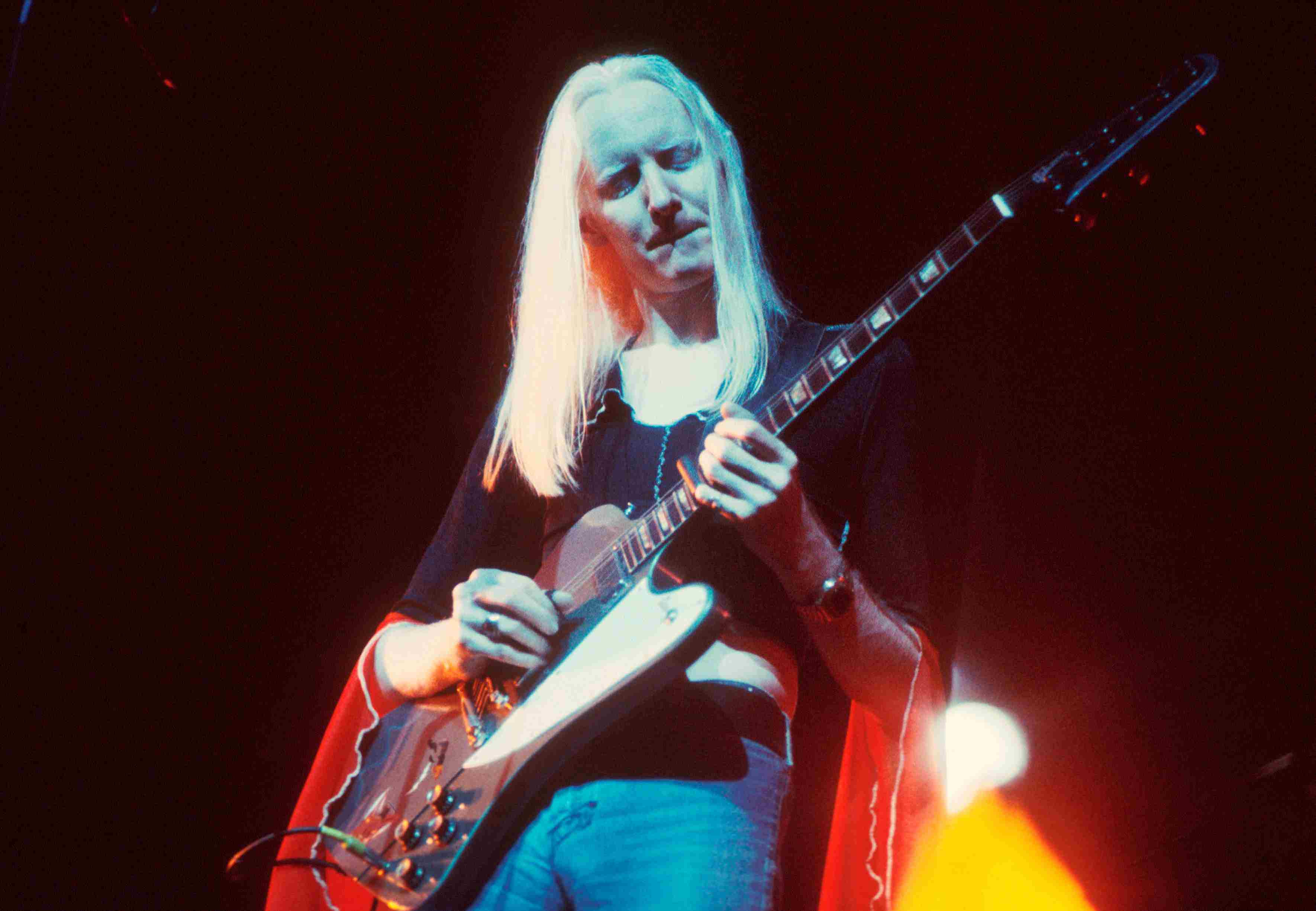Johnny Winter playing guitar