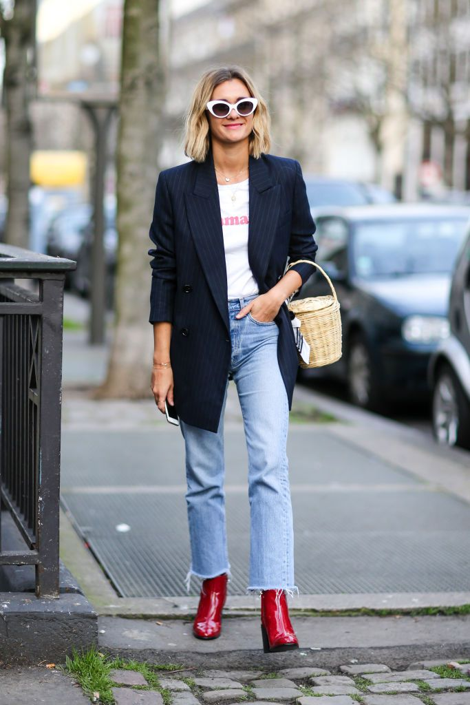 Woman in black blazer and straight leg jeans
