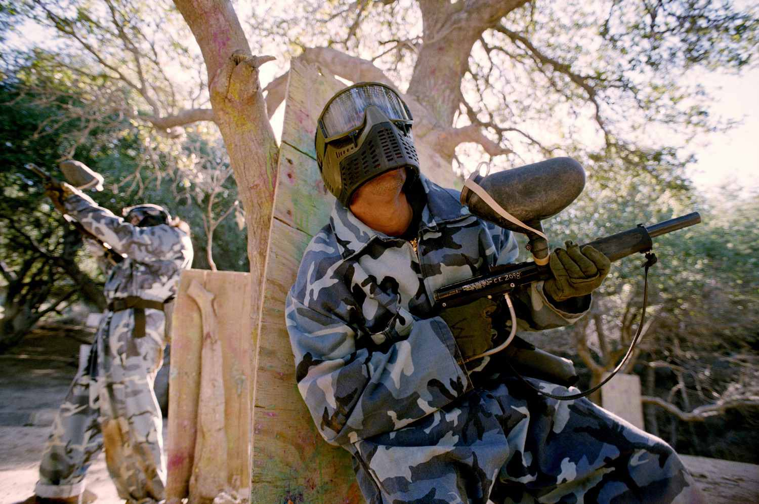 Men in camouflage holding paint guns