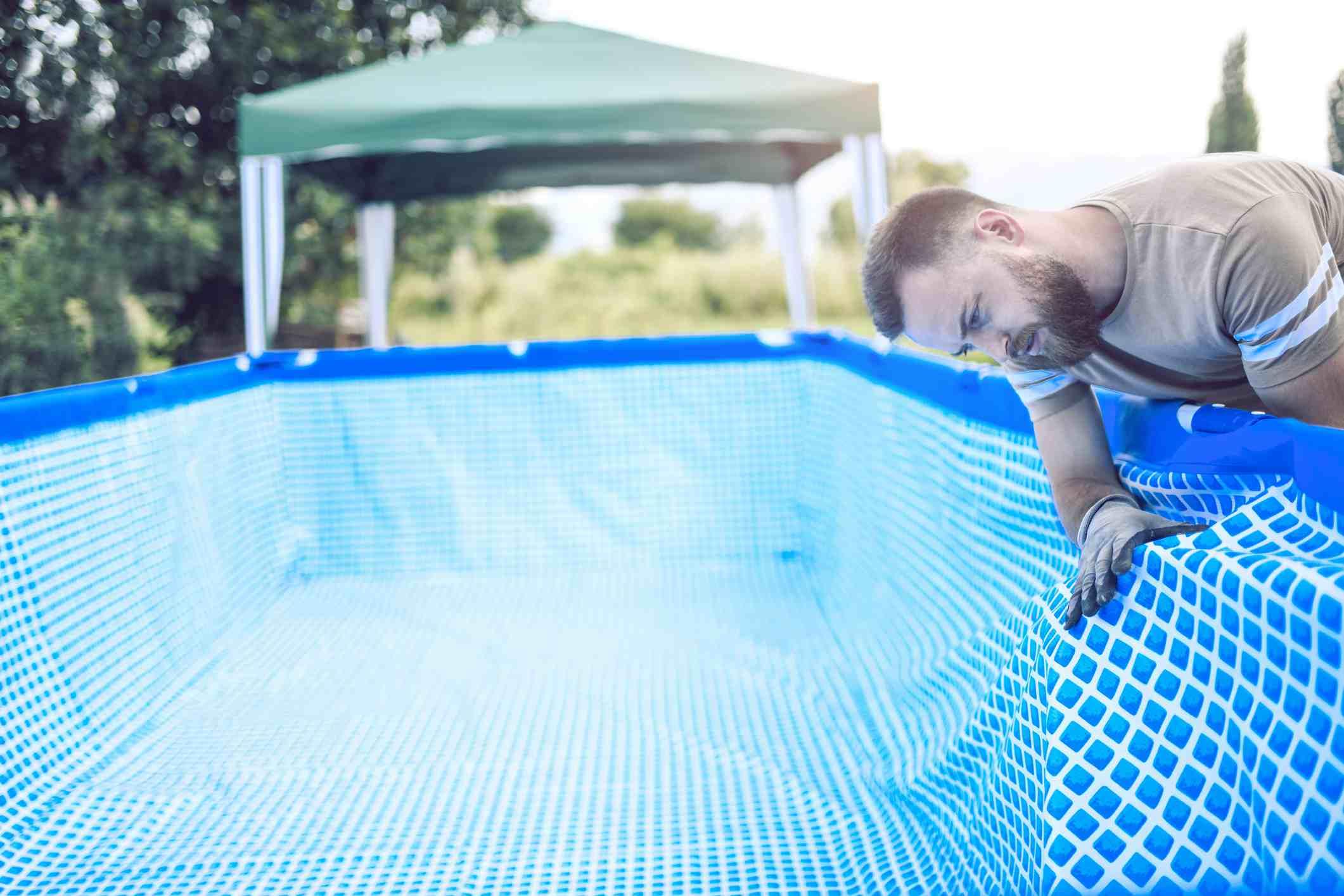 man installing pool