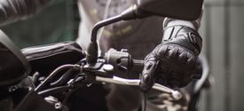 Close up of motorcycle rider's hand on clutch