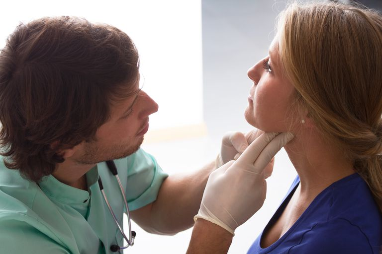 Doctor examining an patient's throat