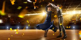 Couple dancers ardently perform the latin american dance on a large professional stage with sparkle fireworks