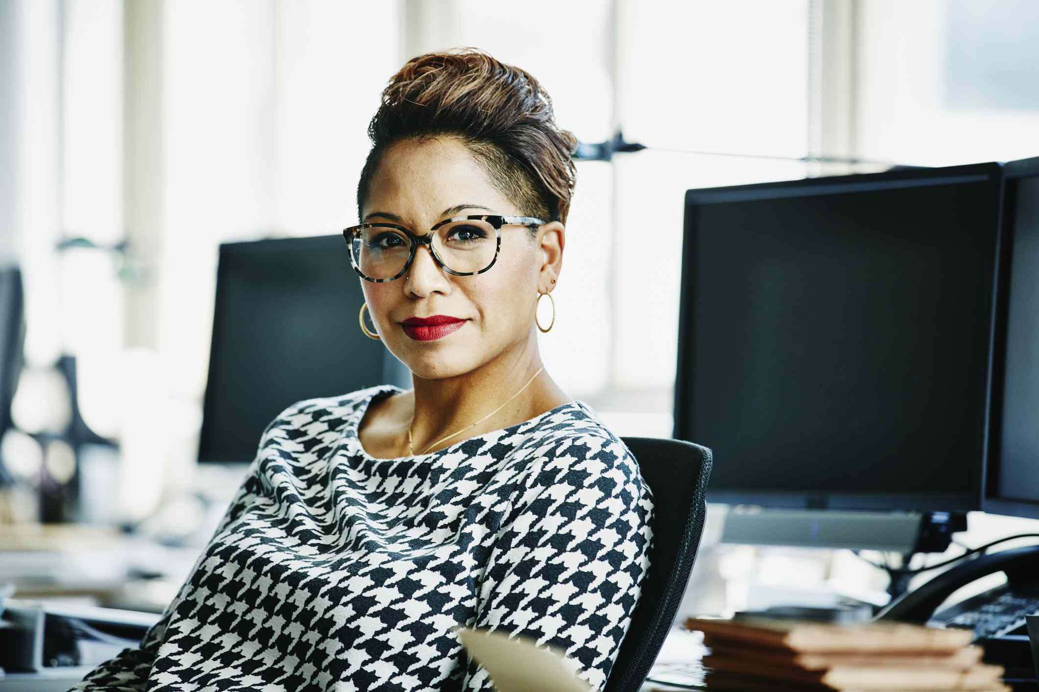Woman with glasses at desk