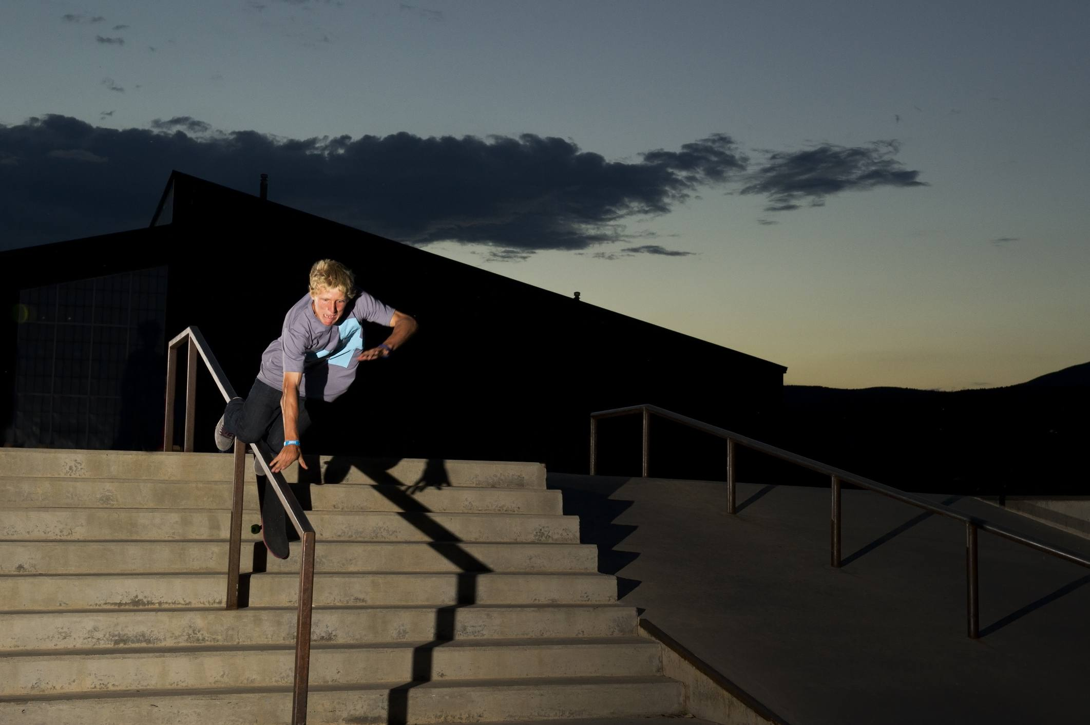 Skateboarder without helmet crashes down stairs