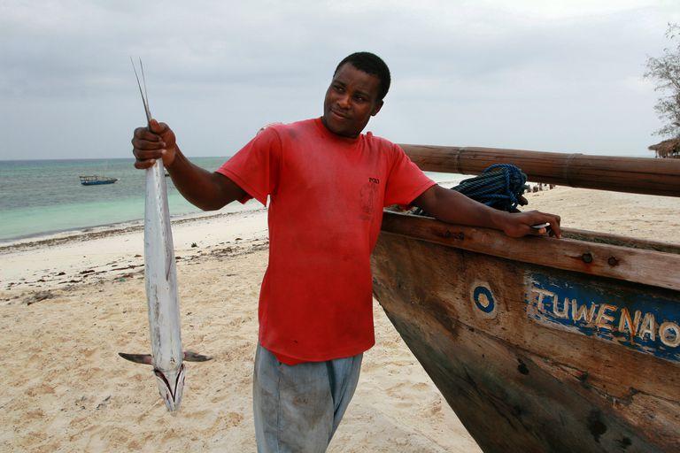 black Fisherman holding Kingfish, Zanzibar