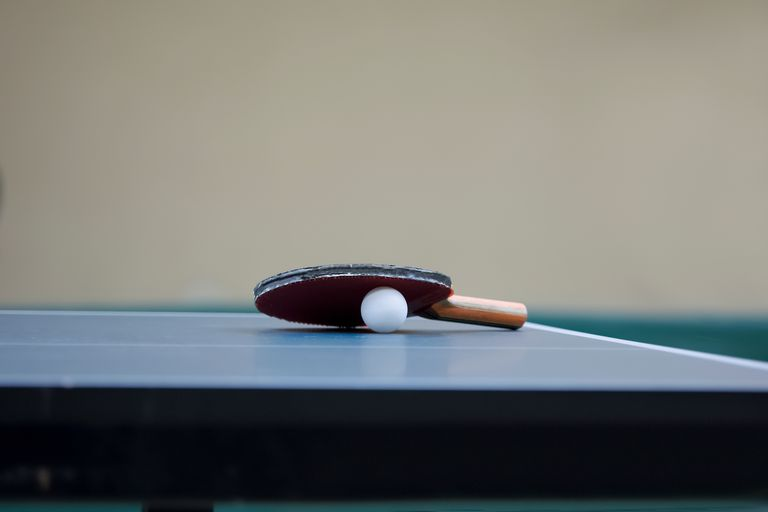 Table Tennis Racket And Ball On Table