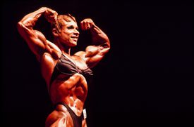 female bodybuilder flexing