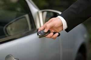 Man's at car using remote control key