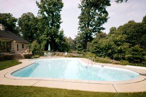 A crystal clear backyard pool