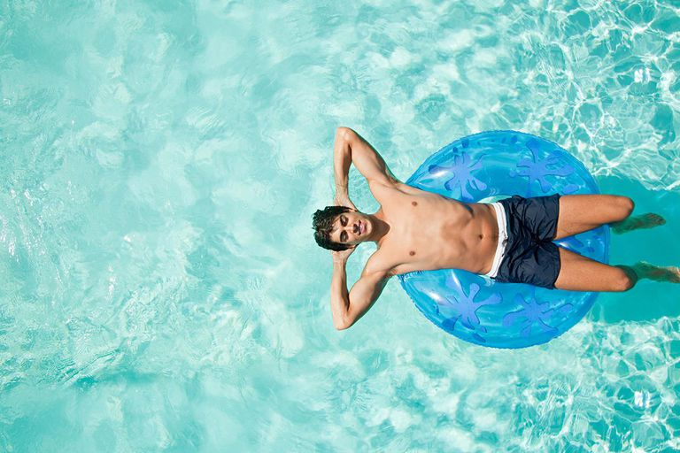 Man on inflatable ring in pool