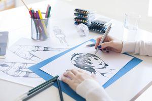 Manga artist drawing a face