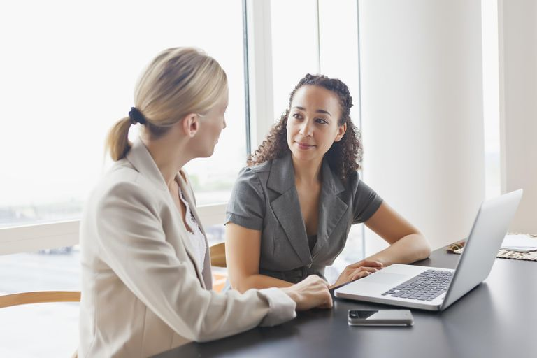 Woman listening to co-worker attentively
