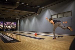 woman bowling in a bowling alley