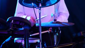 Midsection Of Person Playing Drums