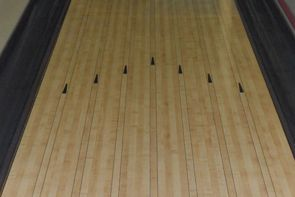 A bowling lane surrounded by gutters.