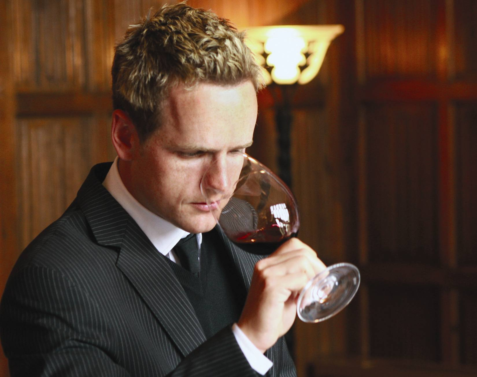 Luke Donald checks the bouquet of one of his wines