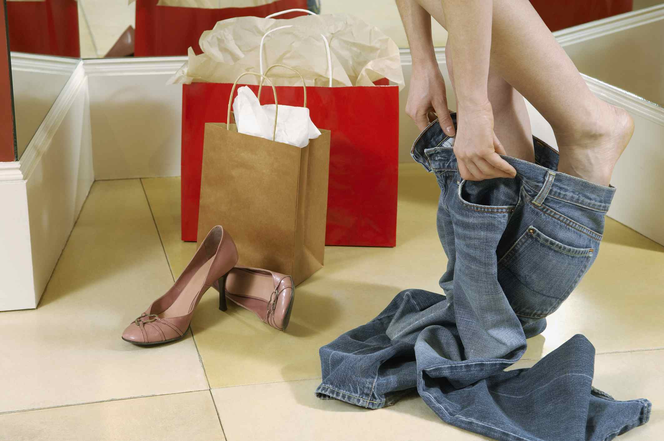 Woman trying on jeans in store change room
