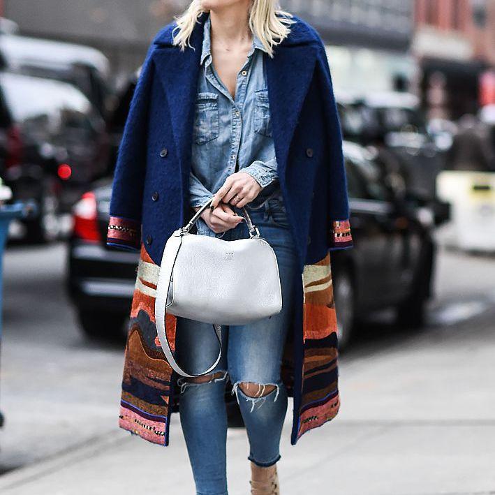 Street style long coat over denim