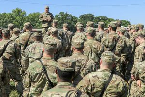 Soldiers being briefed after arriving at Fort Polk