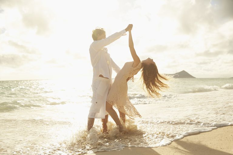 Couple dancing in the ocean