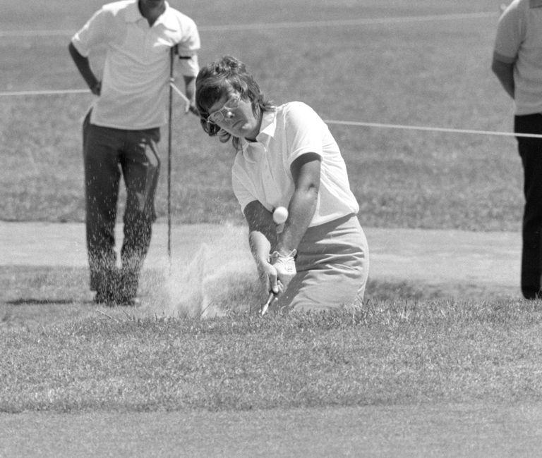 Golfer Sandra Haynie plays a bunker shot