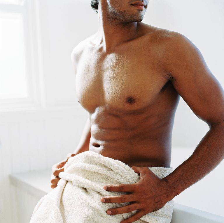 Portrait of a young man with a towel around his waist
