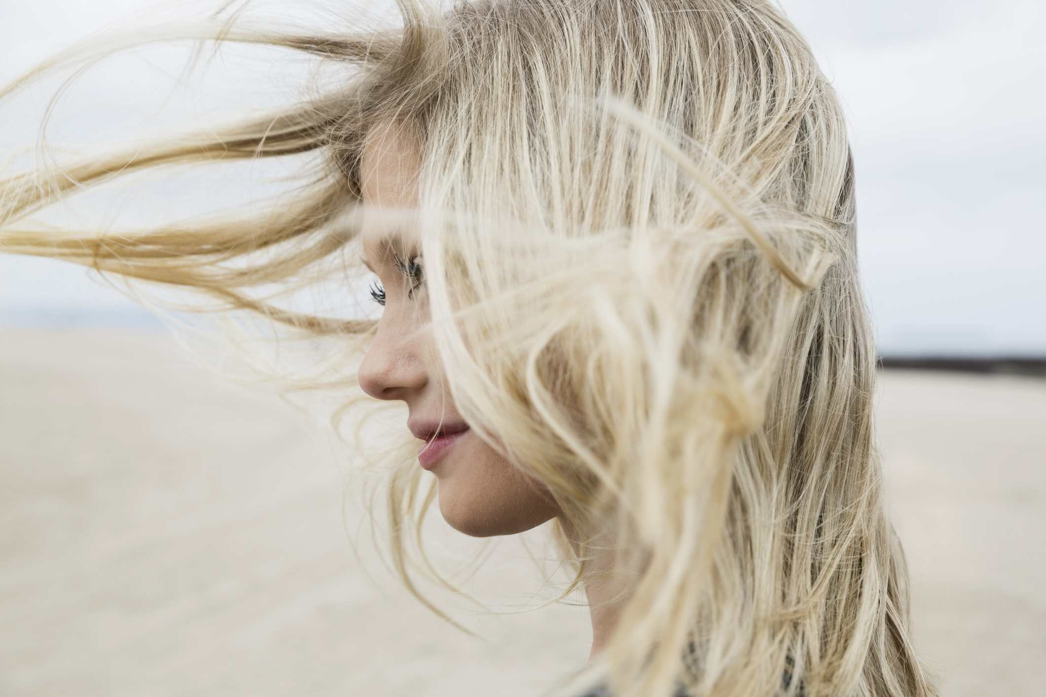 Blonde haired woman on beach