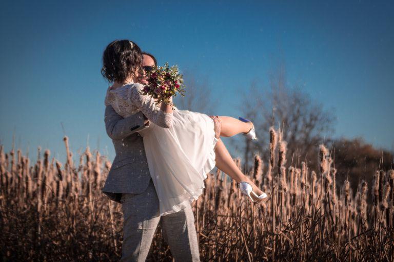 wedding couple in field