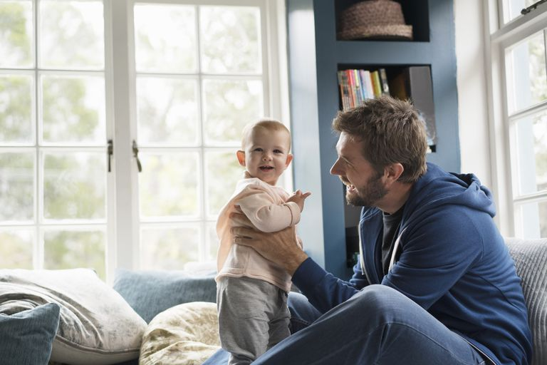 Father holding baby quality time