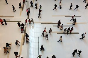 People walking in a mall.