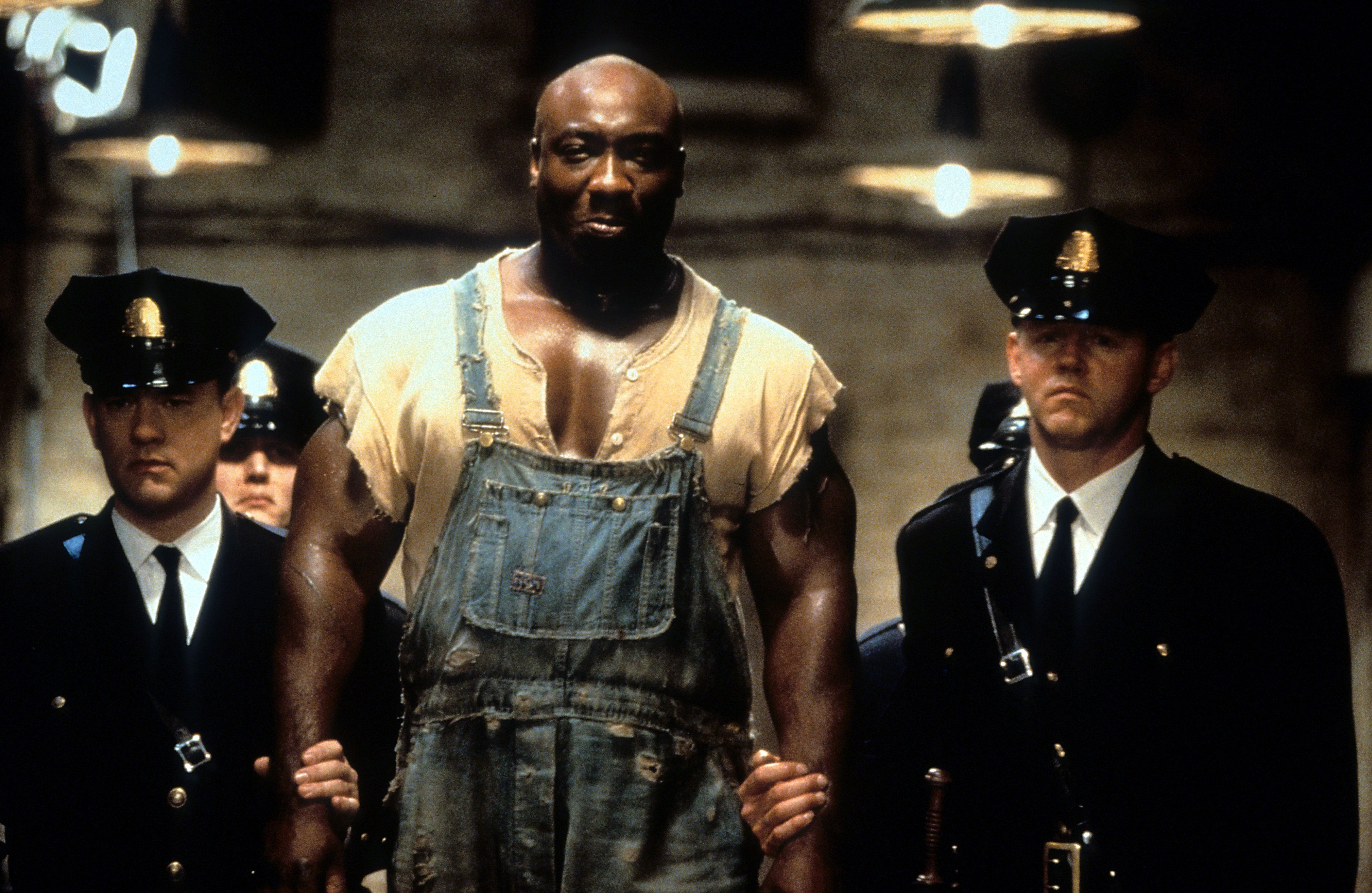 Michael Clarke Duncan is walked down a hall in a scene from the film 'The Green Mile' (1999)